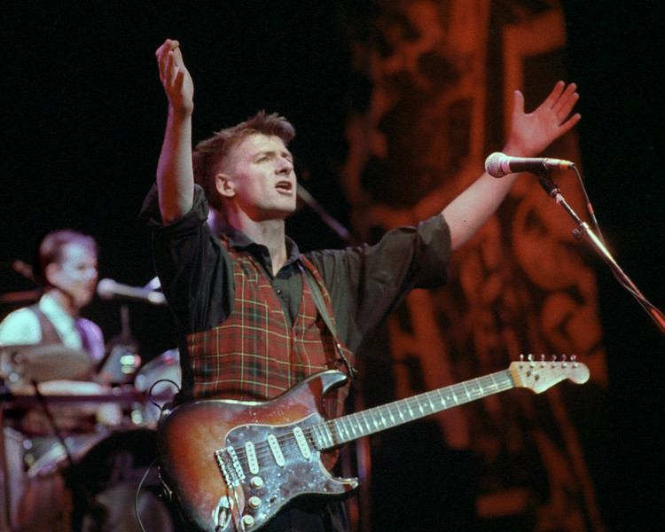 Neil Finn performing live on stage with Crowded House at the Warfield Theater in San Francisco on April 5, 1989.