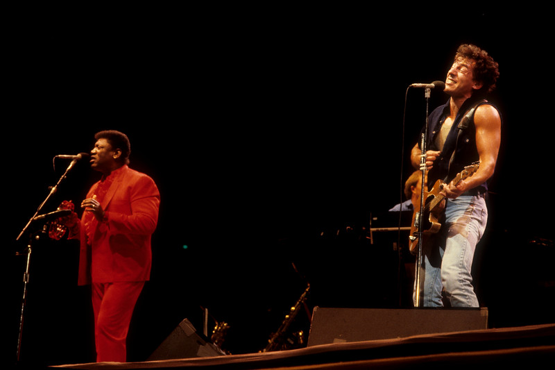Clarence Clemons (L) and Bruce Springsteen perfoming with the E Street Band at the Oakland Stadium on September 19, 1985.