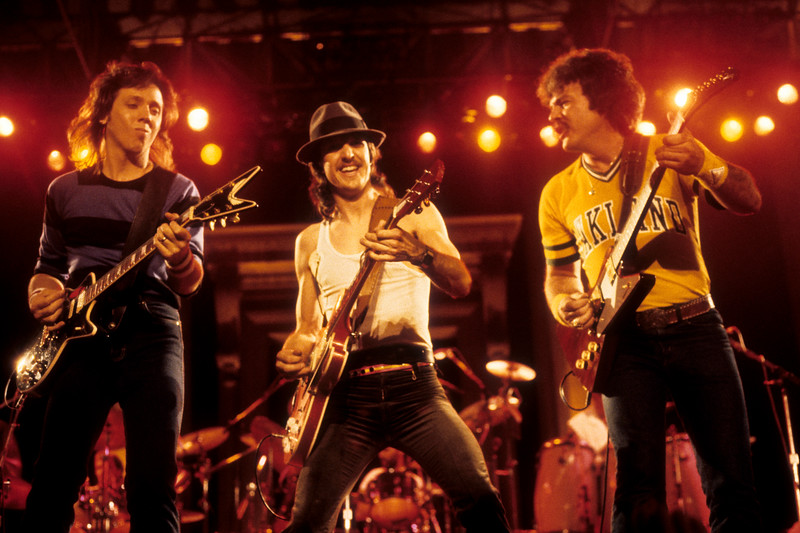 "The Doobie Brothers perform their ""farewell"" show, at the Greek Theater in Berkeley, CA on Sept. 11, 1982. L-R: John McFee, Pat Simmons, Tom Johnston."