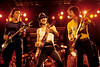 """The Doobie Brothers perform their """"farewell"""" show, at the Greek Theater in Berkeley, CA on Sept. 11, 1982. L-R: John McFee, Pat Simmons, Tom Johnston."""