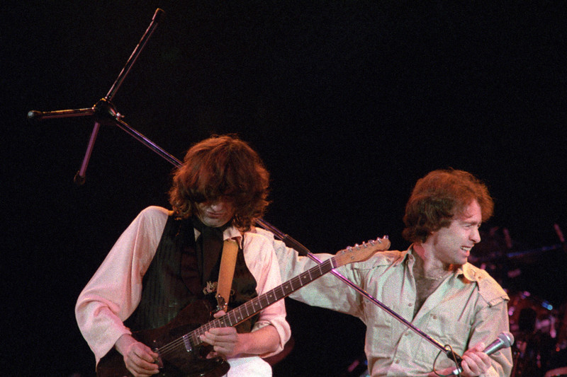 Jimmy Page and Paul Rodgers performing at the A.R.M.S. benefit concert at the Cow Palace in San Francisco on December 3, 1983.