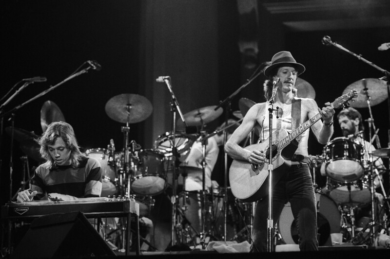 BERKELEY, CA-SEPTEMBER 11: The Doobie Brothers perform at the Greek Theater in Berkeley, CA on September 11, 1982. (L-R: John McFee, Patrick Simmons, Keith Knudsen) (Photo by Clayton Call/Redferns)