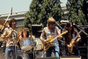 Jefferson Starship performing at Vallaincourt Plaza in San Francisco in October 1979. (L-R): Mickey Thomas, Aynsley Dunbar, Paul Kantner, Craig Chaquico.