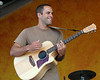 Jack Johnson performing live on stage at the New Orleans Jazz & Heritage Festival on April 28, 2005.