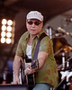 Paul Simon performs at the New Orleans Jazz & Heritage Festival on May 4, 2001.