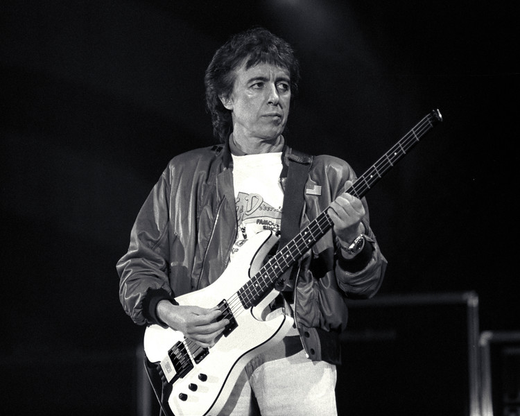 Bill Wyman performs with the Rolling Stones at the Oakland Stadium on November 4, 1989.