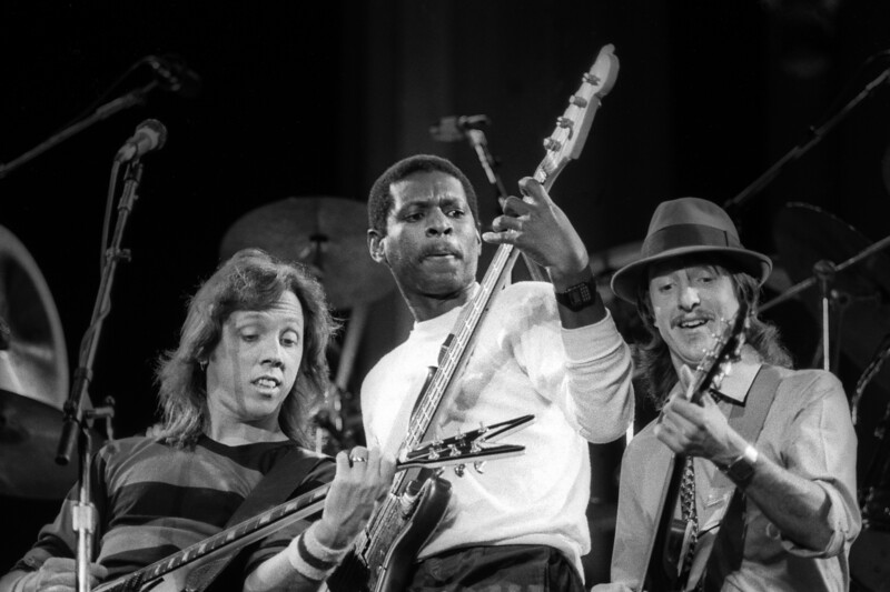 BERKELEY, CA-SEPTEMBER 11: The Doobie Brothers perform at the Greek Theater in Berkeley, CA on September 11, 1982. (L-R: John McFee, Willie Weeks, Patrick Simmons)  (Photo by Clayton Call/Redferns)