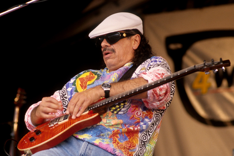 Carlos Santana performs with his band at the New Orleans Jazz & Heritage Festival on April 26, 1997.