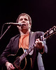 Paul Simon performs at the Oakland Coliseum on January 13, 1991.