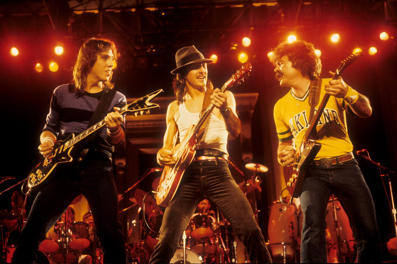 BERKELEY, CA-SEPTEMBER 11: The Doobie Brothers perform at the Greek Theater in Berkeley, CA on September 11, 1982. (L-R: John McFee, Patrick Simmons, Tom Johnston  (Photo by Clayton Call/Redferns)