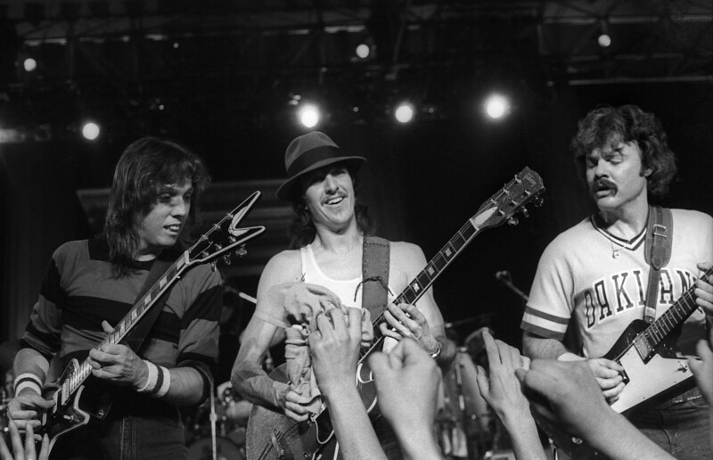 BERKELEY, CA-SEPTEMBER 11: The Doobie Brothers perform at the Greek Theater in Berkeley, CA on September 11, 1982. (L-R: John McFee, Patrick Simmons, Tom Johnston)  (Photo by Clayton Call/Redferns)