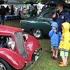 Swampscott, Ma. 10-8-17. Tristan Diamond Petors Kopalidis and George Kopalidis look at a 1934 Ford at the seventh annual Classics by the Sea Car Show at Swampscott Town Hall on Sunday.