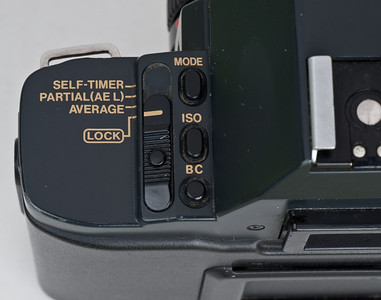 Canon T70 - Note switch for metering.