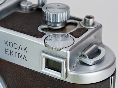 Kodak Ektra, showing slow-speed shutter dial in front and high-speed dial above and behind it; shutter release is at upper right