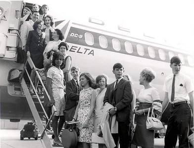 Georgia students getting of the plane.  1966