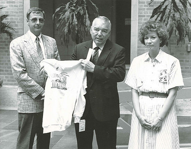 Dan and Debbie Paschal, chaperones with the Illinois Youth to Washington tour, at USDA with an REA representative during the 1990 tour.