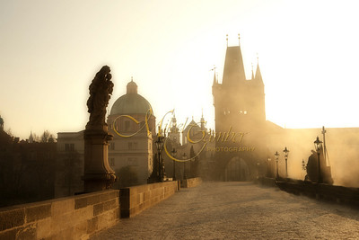 Early morning fog rolls in over the Charles bridge in Prague.