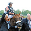PHOTO BY SKIP DICKSTEIN  - SARATOGA RACE COURSE  - JULY 26, 2008 - COMMENTATOR WITH JOCKEY JOHN VELAZQUEZ WINS THE 81ST RUNNING OF THE WHITNEY GI AND IS LEAD TO THE WINNER'S CIRCLE BY TRAINER NICK ZITO(L) AND OWNER TRACEY FARMER(R).