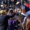 Breeders Cup October 30, 2004 RICK SAMUELS PHOTO<br /> <br /> Trainer Don Chatlos congratulates jockey David Flores after winning the Mile aboard Singletary