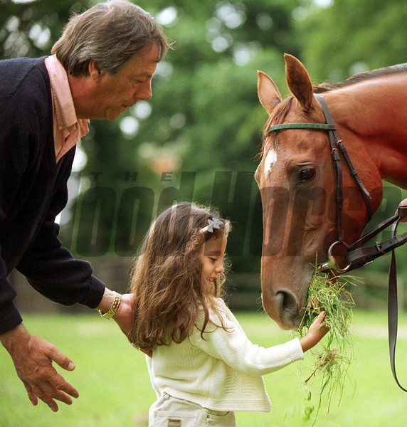 Newmarket 21/6/99.<br /> Trainer Henry Cecil is at hand as  Princess Reema feeds grass to her father Prince Fahd Salmaan's Oaks winning filly Ramruma named after her.<br /> ©Trevor Jones