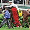 SUPER SAVER and Calvin Borel WITH ROSES<br /> Dave Harmon Photo