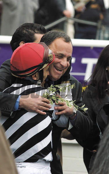 Bobby Frankel hugs  John Velazquez  after winning the FMTurf.<br /> Oct. 26, 2002, Arlington.<br /> JUVOrigs2image19<br /> PHoto by Anne M. Eberhardt