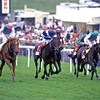 Reams of Verse (pink cap) wins the 1996 Oaks<br /> Sir Henry Cecil<br /> Trevor Jones Photo