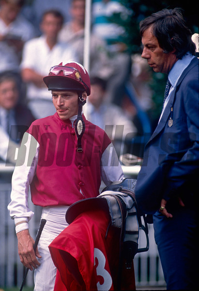 Steve Cauthen (left) in the colours of Sheikh Mohammed with trainer Henry Cecil in the winners enclosure at York .