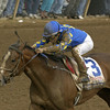 Harlan's Holiday with Edgar Prado up wins the Blue Grass Stakes (gr. I) at Keeneland on April 13, 2002.<br /> BlueGrassOrigs2 image 59<br /> Photo by Anne M. Eberhardt