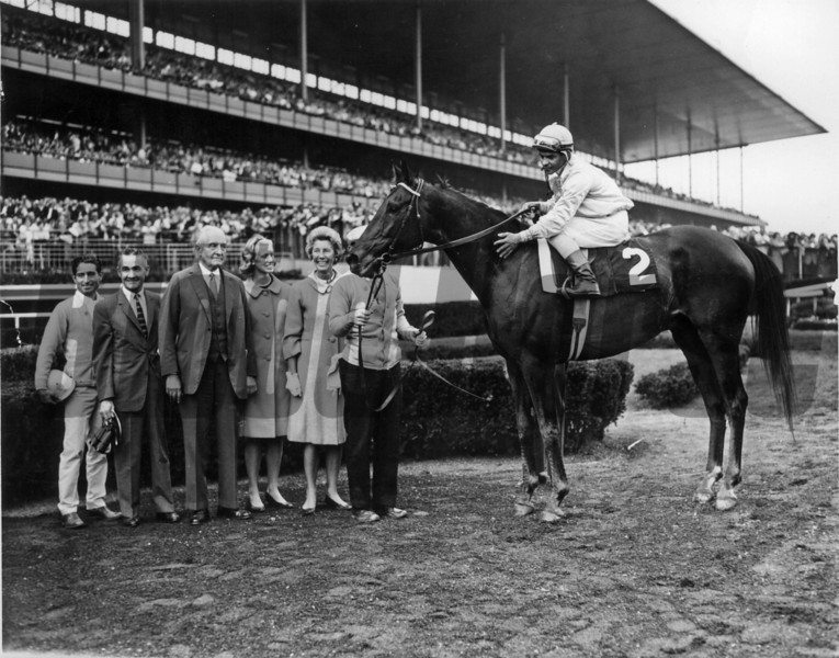 Kelso with jockey Ismael Valenzuela wins the Woodward Stakes. L to R exercise rider Dick Jenkins, trainer Carl Hanford, Mrs. Dupont's father Samuel A. Crozer, Lana Dupont, and Mrs. Richard C. Dupont.<br /> Photo by: Bob Coglianese