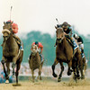 Lil E Tee and jockey Pat Day (left) wins the 1992 Kentucky Derby at Churchill Downs.<br /> Photo by: Skip Dickstein