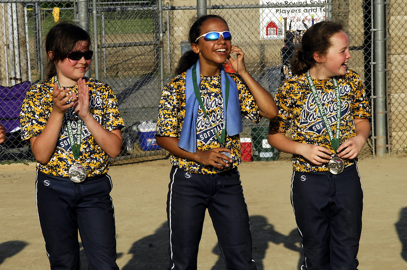 STAN HUDY - SHUDY@DIGITALFIRSTMEDIA.COM<br /> Classie Lassies Boom 10U all smiles with 2nd place medals