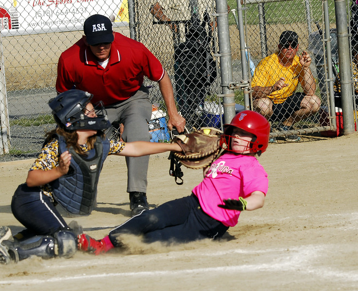 STAN HUDY - SHUDY@DIGITALFIRSTMEDIA.COM<br /> Classie Lassies Boom catcher Joslyn TealNatalia Mancino applies a tag high up on Saratoga Miss Thunder 10U base runner Olivia Tetreault who raced all the way around the base path after a successful bunt attempt in Sunday's championship game of the Miss Shen Slide into Summer tournament.