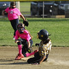 STAN HUDY - SHUDY@DIGITALFIRSTMEDIA.COM<br /> Classie Lassies Boom Teagan Kreshik slides safely into second base under the tag of Saratoga Miss Thunder Red's Ryann Allen in the Slide into Summer championship game.