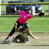 STAN HUDY - SHUDY@DIGITALFIRSTMEDIA.COM<br /> Saratoga Miss Thunder infielder Ryann Soltis reaches out and over the slide of Classie Lassies Boom base runner Natalia Mancino during the Miss Shen Slide into Summer 10U championship game Sunday at the Clifton Common.