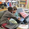 Allendale Elementary School fifth-graders Martin Boua, left, and Quinn Obregon-Lopez talk out the solution to a math problem with decimals. Students are regularly given a range of seating options as well as the option to work independently or with a partner in Anne-Mary Riello's classroom. JENN SMITH — THE BERKSHIRE EAGLE
