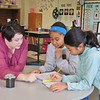 From left: Allendale Elementary School fifth-grade teacher Anne-Mary Riello offers some tips to Amalia Lamb-Gardiner and Sharleen Barahona, who are working together to solve a math problem with decimals. Students are regularly given a range of seating options as well as the option to work independently or with a partner. JENN SMITH — THE BERKSHIRE EAGLE