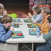 "Richmond Consolidated School third-graders eat lunch with their ""senior friends"" Monday, during their monthly mentorship visit. The intergenerational program has continued at the school for more than 20 years."