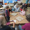 Richmond Consolidated School third graders play Scrabble at this month's meeting with their 'senior friends.' Volunteers from the town have been coming to third-grade classrooms for more than 20 years to mentor the children on a monthly basis.