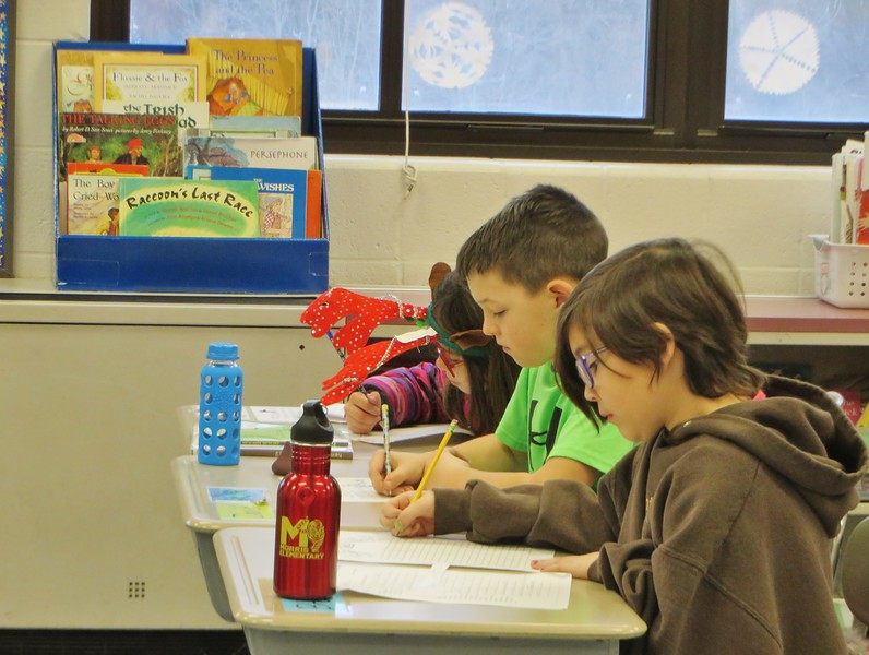 Sarah Gerney's third-grade students at Morris Elementary School in Lenox enjoy their creative writing work. Here, Brooklyn Rodriguez, David Kirchner and Emery Lipton seem to have a laser focus on what they're working on.