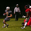 (Friday October 11th 2013 - Clawson High School - Clawson, MI) Clawson High's Nick Magil-Diaz runs the ball into Lincoln territory during Friday's homecoming game. Photo by: Brian Sevald