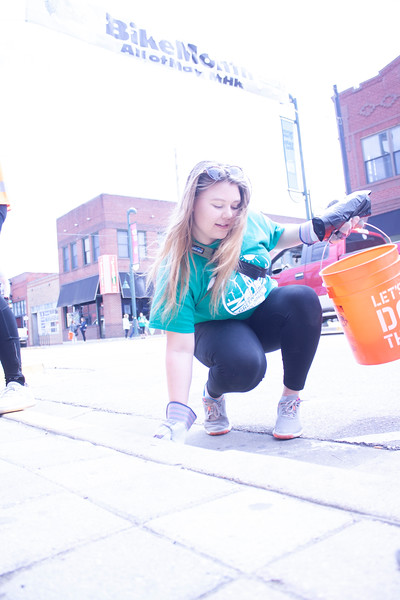 Cheyenne Butler, junior in biological systems engineering and Green Week chair of Students for Environmental Action, picks up litter as part of Clean Up MHK on Sunday, April 22, 2018. (Tiffany Roney | Collegian Media Group)