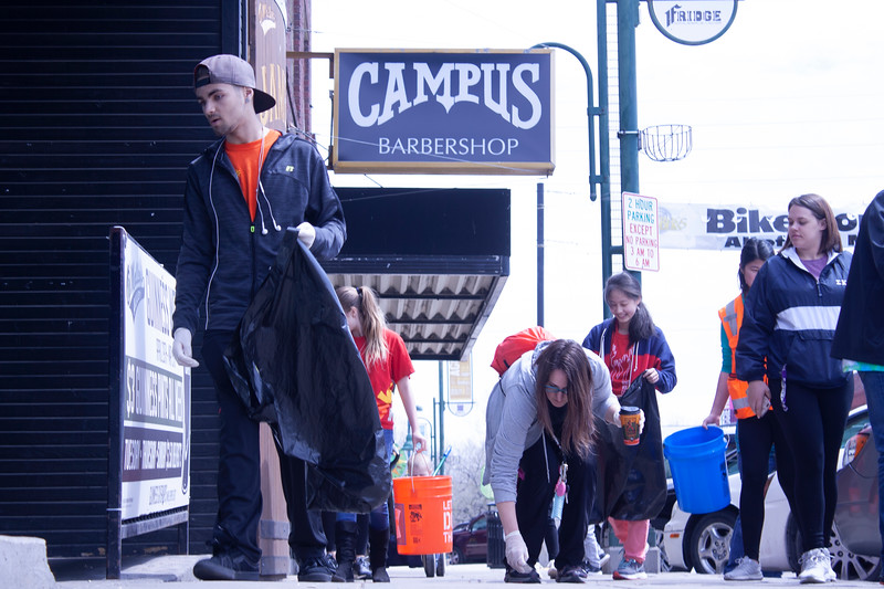 Volunteers help rid Aggieville of litter as part of Clean Up MHK on Sunday, April 22, 2018. The event was part of Green Week, presented by Students for Environmental Action, K-State's Office of Sustainability and Housing & Dining Services. (Tiffany Roney | Collegian Media Group)