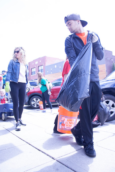 Matt Delashmit, junior at Manhattan High School, and Halley Hartenbower, program manager for the National Bio and Agro-defense Facility, volunteer at Clean Up MHK in Aggieville on Sunday, April 22, 2018. (Tiffany Roney | Collegian Media Group)