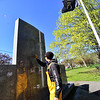 KRISTOPHER RADDER — BRATTLEBORO REFORMER<br /> Tony Lebron, maintenance worker for the Brattleboro Recreation Department, uses a power washer to remove graffiti on a war memorial on the Common, in Brattleboro, Vt., on Monday, May 4, 2020.