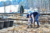 Members of the Brattleboro Floral Arts and Garden Club clean up the park near the Creamery Covered Bridge on Wednesday, March 17, 2021.