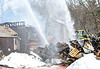 KRISTOPHER RADDER - BRATTLEBORO REFORMER<br /> Crews use an excavator to remove debris so they are able to spray water on various hotspots during a three-alarm fire at 55 Brisk Lane in Brattleboro on Tuesday, Feb. 21, 2017.