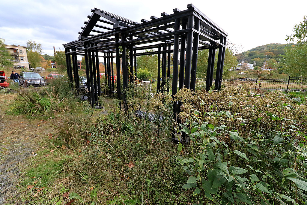 . Gardeners & volunteers cleaned up the Gateway Park Community Gardens in Fitchburg on Saturday, October 20, 2018. They pulled weeds racked the area and fixed the walkway. they also had new wood to build new garden beds. The wood was gotten through the Gateway Park fund and with some help from Growing Places. You can see the weeds growing around the pergola in the garden area. SENTINEL & ENTERPRISE/JOHN LOVE