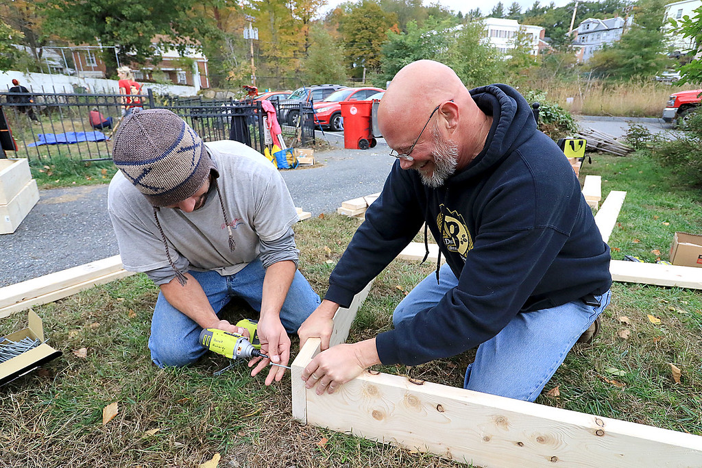 . Gardeners & volunteers cleaned up the Gateway Park Community Gardens in Fitchburg on Saturday, October 20, 2018. They pulled weeds racked the area and fixed the walkway. they also had new wood to build new garden beds. The wood was gotten through the Gateway Park fund and with some help from Growing Places. Volunteers Nick Squailia and Kevin Wiggs work on building the flower beds. SENTINEL & ENTERPRISE/JOHN LOVE