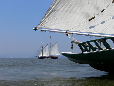 The sloop Mystic Whaler at full sail passing the Hudson RIver Sloop Clearwater.